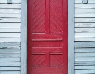 Red door, grey wall