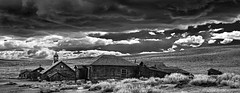Under a Dark Cloud (Rennett Stowe) Tags: storm stormclouds startrek clouds sublime ghosttown bodiecalifornia bodieghosttown abandoned deserted homestead oldhomestead theoldwest thewest manifestdestiny westwardexpansion modernity stuff materialism materialistic creativecommons blackandwhite canonblackandwhite blackandwhitepanorama panorama oldtown abandonedtown church oldchurch verydarkstorm darkstorm underacloud livingunderacloud ominous evil weather tornadoweather dangerousweather woodenbuidlings woodentown oldwoodentown powerpoint architecture movielocation filmlocation californiastatepark depressed depression sad sadness empty igiveup vacation travel ngc preludetodarkness thecomingstorm thelastdays termination lost lostcity sensual anemptyland openprairie allalone coldwind lonelywind mystery desolation theendofdays purgatory drama westernmovielocation westernfilms