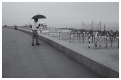 Umbrella In TheMist (oiZox) Tags: umbrella mist white waiting europe exterior grey town travelling urban urbano incontri imperatore introspectus orlandoimperatore ombreeluci orlando observing people photography photo portugal nikon negro nero light lux life licht luz lines libre love look kultur journey happy human happiness harbour humans gente fotourbana d750 depthoffield dof streetphotagraphy street shadow silhouette zox zoximage zwart zee sea seaside city calle citta callejera ciudad cityscape viaggiare blackwhite blanconegro bw monocromatico mono mensen monochrome beach water sky nature clouds