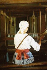 Weaver - La Purisima Mission - Lompoc, California (Caroline Kutchka Folger) Tags: lompoc california weaver historicalreenactment mission elcaminoreal film travel roadtrip smalltown 35mm woman weaving craft