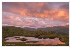Sunrise reflected - Explored (Lynne J Photography) Tags: angletarn sunrise water hills reflections landscape color clouds tarn waterfalls longexposure fire lake district