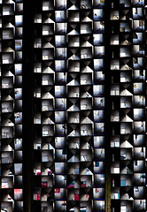 urban, night (Reflectory (Chris Brown)) Tags: abstract abstraction nonobjective square triangle rectangle pattern grid rows columns black white gray red blue blackbackground vertical metal mesh screen window wall building urban city night light shadow reflectory