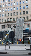 3 men vs wall of concrete (adeel256) Tags: building contruction workers concrete builders crane lifter windows tower high vis visibility road suspended hanging conrete slab metro city loading