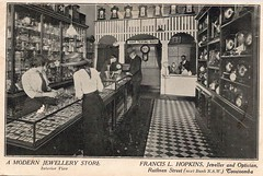 Interior of store of Francis L. Hopkins, Toowoomba, Qld - early 1900s (Aussie~mobs) Tags: vintage queensland australia francislhopkins jeweller interior shop store optician showcase shopassistant