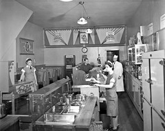 Four-Star Restaurant, interior view of the wait staff and customer, 1942 (Brett Streutker) Tags: restaurant cafe diner eatery food hamburger cheeseburger eat fast macdonalds burger vintage colonel sanders kentucky fried chicken big mac boy french fries pizza ice cream server tip money cash out dining cafeteria court table coffee tea serving steak shake malt pork fresh served desert pie cake spoon fork plate cup drive through car stand hot dog mustard ketchup mayo bun bread counter soda jerk owner dine carry deliver monochrome people