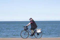 Cycling by the sea (Gill Stafford) Tags: gillstafford gillys image photograph wales northwales llandudno conwy resort holiday trippers day holidaymakers tourist beach august summer seaside cyclist recreation
