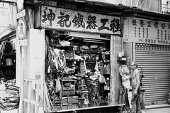Metal Shop (superzookeeper) Tags: eos1 analog film ilford hk hongkong ilforddelta100 delta100 canoneos1 ef2470mmf28liiusm monochrome blackandwhite eos bnw favorites people oldman metalshop saiwan western over1000views street