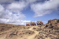 Land Rover Tour (Explore) (G-daddyArt) Tags: canon50d rocks arikoknationalpark landrover aruba trail naturalpool cloudscape explore