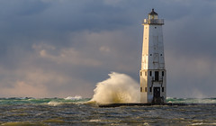 Mr. Brightside (Aaron Springer) Tags: michigan northernmichigan lakemichigan thegreatlakes frankfortlighthouse novembergale breakingwave waves storm lighthouse sunlit outdoor nature landscape