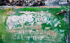 Veridious Obscuration (Junkstock) Tags: aged abandoned artifact artifacts advertisement advertising altebenutztegegenstände color california campo corrosion corroded craquelure decay decayed distressed graphics graphic green abstract abstraction old oldstuff oldusedobjects oldandbeautiful paint peelingpaint patina rust rusty rusted relic textures texture typography type text weathered