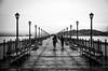 The girls (Rabican7) Tags: cahi landscape port bw monochrome girls pier rainy umbrellas blackwhitephotos california sanfrancisco city seaside streetlamps streetphotography photography traveling benches walking