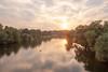 Ruhr River from the Nachtigallbrücke in Witten (IanHartS) Tags: witten deutschland nikon d700 river germany outdoors sunlight 20mmf18g plants trees sunset nordrheinwestfalen de