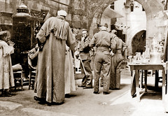 Mar  1942 - British Royal Air Force ground crew troops bartering with local Arab traders at a bazaar in a narrow back alley of Cairo, Egypt (aussiejeff) Tags: tombeazley middleeastcairo 2ndaustralianimperialforce british royalairforce raf groundcrew troops soldiers military arab traders shops group alley cairo egypt bw blackandwhite bnw vintage antique bazaar war ww2 wwii jeffc aussiejeff