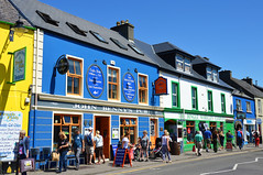 Colours of Dingle (angelsgermain) Tags: street houses buildings colours windows roofs doors sidewalk shops pub ads people summer town dingle andaingean countykerry ireland éire