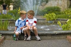 the Fight (l i v e l t r a) Tags: 85mmf14d f2 tension children fountain park vein water fight kids boys flowers greenery nikond3