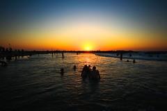 Bathing at sunset - Tel-Aviv beach (Lior. L) Tags: bathingatsunsettelavivbeach bathing sunset telaviv beach sea seascapes silhouettes people sky travel travelinisrael israel landscape
