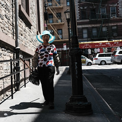 Glowing Hat (Zach K) Tags: hat cap glowing backlit blue light mosco street new york city nyc chinatown hill walk downhill shadow sunlight beam fujifilm fuji x100f classic chrome lower manhattan urban photography streetphotography bright hot summer