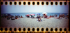 beachlife III (Ulla M.) Tags: beach beachlife sprocketrocket selfdeveloped selbstentwickelt sprocketholes umphotoart panoramaformat analog canoscan8800f lomo freihand analogue film kleinbild 35mm mittelmeer mediterraneansea ishootfilm