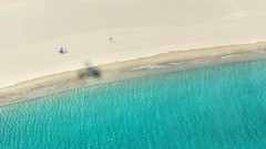 Perfect shoreline overflight. (BadGunman) Tags: sunbath people barcarès pyrénéesorientales blue sea france aviation aircraft plane shoreline sunshine water beach sand shadow sun flight