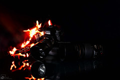 My burning camera..!! (Jams Nabil) Tags: canon burning camera canonlove fire explore createxplore flickr best photography photographs photos photo pic pictures worldwide flickrunitedaward