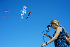 Peek (dtanist) Tags: nyc newyork newyorkcity new york city sony a7 konica hexanon 40mm brooklyn coney island beach shore kite kites skeleton skeletons phone