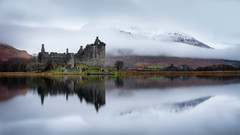 As time passes by . . . (Pete Rowbottom, Wigan, UK) Tags: kilchurncastle lochawe scotland landscape moody scottish argyll loch water lake waterreflections castle ancient historic mountains clouds fog mist peterowbottom red yellow art blue outdoor westhighlands symmetry earlymorning dawn sunrise scotland2017 trees cold uk uklandscape scottishlandscape highlandsandislands dalmally oban driftingfog nikond750 wideangle hills munro dramatic landmark beautiful peaceful calm serene stillwater glenorchy mirror longexposure slowshutter snow snowymountain geotagged