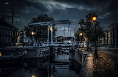 Sint Maartensbridge (VandenBerge Photography (and we're back again)) Tags: illuminate goes zeeland bridge thenetherlands city cityscape reflection night evening water europe canon lights atmosphere mood editing magical