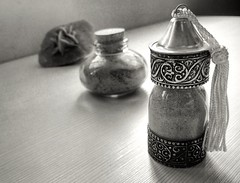 Memories with certain wet taste. (Helen-Atn) Tags: sand morocco wet bottle bw memories desert rose