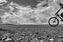 imperfectly into the picture (Georgie Pauwels) Tags: fujifilm ruhrarea heap mound bicycle bike minimal public street unperfect half streetphotography candid blackandwhite