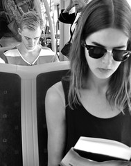 In Oslo, Norway (JasChamPhoto) Tags: norwegian handsome monochrome passenger blond youth reading sunglasses youngwoman publictransportation bus norway oslo candid man male guy dude
