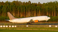 737-400SF Golden Hour. (spencer_wilmot) Tags: örebro departure 737 specialfreighter 737400sf 734 b734 b737 boeing sunset goldenhour trees runway ramp aviation aircraft airplane airliner airport taxiway takeoff sweden cargo freight freighter aslairlinesireland agabr ag abr contract dusk evening eveninglight orbesoe orb esoe rotation rotate liftoff civilaviation commercialaviation jet jetliner orange plane twin eistm