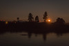 D18597E7 - Backlit Trees At Waters Edge (Bob f1.4) Tags: night photography silhouette trees back lit light red lights windmills for elctricity california ca sacramento delta by waters edge from boat anchored water