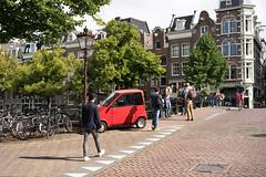 Little red car (jamiethompson01) Tags: amsterdam summer sony a7 mk2 mkii zeiss carl 55mm 18f ilce7m2 fe f18 za street people bike