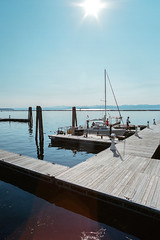 "Burlington (Peter Gutierrez) Tags: photo united states america american americana usa east eastern north northern northeastern northeast ""new england"" lake champlain vermont chittenden burlington wooden dock docks coast coastal sea seaside lakeside water adirondacks mountain mountains harbor harbour boat boats marina sail sailing sailboat sailboats peter gutierrez ""peter gutierrez"" film photograph photography"