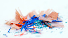 Shavings (Anne Worner) Tags: highkey macromondays anneworner d7000 lensbaby nikon velvet56 abstract blue closeup color colorpencilshavings complementarycolors green macro orange shavings whitebackground