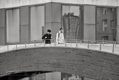 'Arch Friends' (Canadapt) Tags: bridge building men walking railing bw lisbon portugal canadapt reflection friends