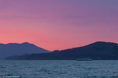 Sunset on the Bay (sierrasylvan) Tags: adobe adobebridgecc2017 adobelightroomcc2015 adobephotoshopcc2017 boat yacht diningyacht californiahornblower buildngs canon canonefs1585mmf3556isusmlens canoneos50d filters hoya hoyahdcircularpolarizingfilter hoyanxthmcuvfilter foothills coastalfoothills pacificcoastranges californiacoastranges sanfranciscobay pacificocean california marincounty angelisland angelislandstatepark sausalito sanfranciscocounty mountain mttamalpais trees tripod manfrotto manfrotto190xprobtripod manfrottobasicpantilthead vivitar vivitarwirelessshutterreleasevivrc200 black blue bouy clouds marinelayer gray hills island landscape orange outdoor pink red shore silhouette sky spring sunset twilight water bay white