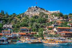 Kaleköy Overlooked By Simena Castle, Antalya, Turkey (Feng Wei Photography) Tags: ancient traveldestinations eastasia exploration mediterraneansea euroasia turkeymiddleeast famousplace lycian simena centralanatolia travel outdoors antalyaprovince horizontal lycia fort castle sunny scenics colorimage turquoisecolored discovery village kaleköy oldruin vacation tranquilscene byzantine kekova kalekoy sea mediterraneanturkey turkishculture tourism trip turkish