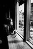 Starbucks girl (Angelo Petrozza) Tags: starbucks girl glass sun light bergen norway mcdonalds blackandwhite biancoenero bw angelopetrozza pentaxk70 1855mm hair profile portrait scandinavia windows