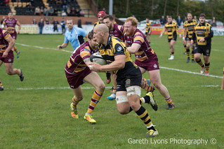 Gareth Turner goes past Sedgley Park's Andrew Riley-7887-7889