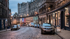 Victoria Street (McQuaide Photography) Tags: edinburgh scotland unitedkingdom greatbritain gb uk sony a7rii ilce7rm2 alpha mirrorless 1635mm sonyzeiss zeiss variotessar fullframe mcquaidephotography adobe photoshop lightroom outdoor tripod manfrotto bluehour building architecture city capitalcity oldtown history historical travel old oldtownofedinburgh longexposure unesco worldheritage street victoriastreet cars parked nopeople 169 widescreen terrace shop shops road car