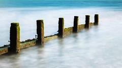 Solent Breakwater (fstop186) Tags: breakwater solent longexposure 10stop sea waves timber bigstopper dreamy movement blue green seaweed algae olympusmzuikoed1240mm128 olympusem1