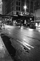 Soggy City In Monochrome -  (3 of 11).jpg (Milosh Kosanovich) Tags: cloudgate block37 statestreet night washingtonstreet bean bw bwfilm minoltax700 kodaktmax400 film wet millenniumpark chicagophotographicart epsonv750pro chicago mickchgo chicagophotographicartscom chicagoist ctal miloshkosanovich cta macys chicagophotoart minolta50mmf14 rain kodak400tmax