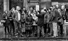 A Unique Photograph (Fermat48) Tags: albertsquare townhall manchester tourguide crowd people mobilephone raining canon eos 7dmarkii blackandwhite bw bandw