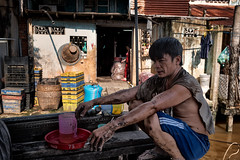 Mekong delta. This farmer just brought manioc with his boat to a local market along the river. (rvjak) Tags: vietnam asia asie southeast manioc farmer boat market marché bateau river rivière mekong cigarette smoking fume people homme man nikon d750