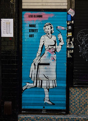 Less Cleaning (Steve Taylor (Photography)) Tags: zabou openinghours apron curtsy paint roller hnrx highheels letterbox art graffiti mural streetart shop blue black pink white tile uk gb england greatbritain unitedkingdom london lines lady woman housewife dress shutter stencil necklace