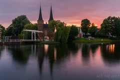 Colorful sunset @ Delft (Marcel Tuit | www.marceltuit.nl) Tags: canon eos historic holland me marceltuit nederland oostpoort thenetherlands architecture architectuur bewegingonscherpte bridge brigde brug city clouds colors contactmarceltuitnl delft gate historie history kleuren langesluitertijd longexposure lucht paars poort purple reflectie reflection sky stad sunset toren tower water wolken wwwmarceltuitnl zonsondergang