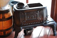Stove, Fort Edmonton Park (ndrisdell) Tags: edmonton alberta canada fort park houseware stove star metal iron wood oven