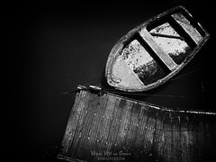 Moored (Mimadeo) Tags: boat moored dock old wooden fishing lake marine pier wood ship nautical tied vessel anchored boating black white blackandwhite noise retro vintage water sea
