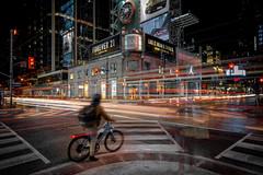 Forever (Paul Flynn (Toronto)) Tags: ttc torontotransitcommission streetcar dundassquare dundas yonge crosswalk bike longexposure traffic night city toronto square billboard road